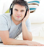 Portrait of a happy man with headphones looking at the camera — Stock Photo