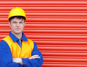 Young worker wearing a hardhat — Stock Photo
