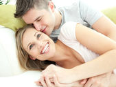 Cute lovers having fun together in the living-room — Stock Photo