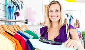 Caucasian woman selecting item — Stock Photo