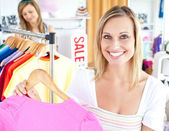 Radiant woman selecting item — Stock Photo