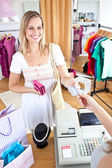Caucasian woman is paying items — Stock Photo