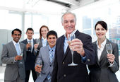 Happy diverse business group toasting with Champagne — Stock Photo
