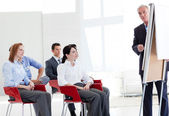 Multi-ethnic business at a seminar — Stock Photo