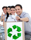 Young business showing the concept of recycling — Stock Photo