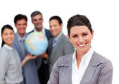 Ambitious business team holding a terrestrial globe — Stock Photo