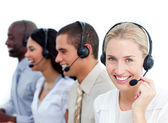 Blond businesswoman and her team working in a call center — Stock Photo