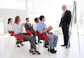 Senior businessman giving a conference — Stock Photo