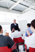 Business applauding the speaker after the conference — Stock Photo