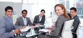 Business group showing ethnic diversity smiling at the camera — Stock Photo