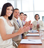 Multi-ethnic business team applauding after a conference — Stock Photo