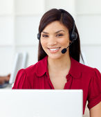 Self-assured Customer service representative using headset — Stock Photo