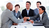 Multi-ethnic business greeting each other — Stock Photo