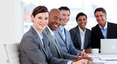 Business group showing ethnic diversity in a meeting — Stock Photo