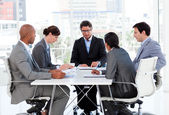 A diverse business group disscussing a budget plan — Stock Photo