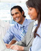 Laughing businessman working with his team — Stock Photo