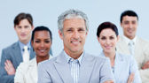 Smiling business team showing ethnic diversity — Stock Photo