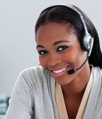 Delighted Afro-american businesswoman using headset — Foto de Stock