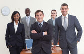 Confident business team standing in a meeting and smiling — Stock Photo