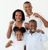 Afro-american family brushing their teeth — Stock Photo