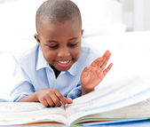 Small boy reading a book — Foto Stock