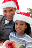 Portrait of an Afro-American father and son holding a Christmas — Stock Photo