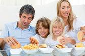 Loving family eating hamburgers — Stock Photo