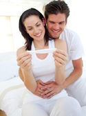Smiling couple finding out results of a pregnancy test — Stock Photo