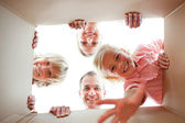 Happy family unpacking boxes — Stock Photo