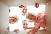 Happy family unpacking boxes — Stock Photo