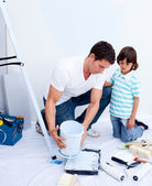 Attentive father and his son decorating their house — Stock Photo