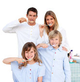 Merry family brushing their teeth — Stock Photo