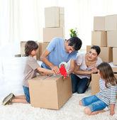 Jolly Family moving house — Stock Photo