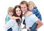 Portrait of family enjoying piggyback ride — Stock Photo