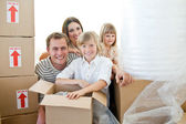 Loving family packing boxes — Stock Photo