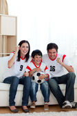 Lively famil ywatching football match — Stock Photo