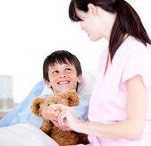 Adorable little boy attending a medical exam — Stock Photo