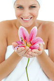 Bright woman holding a flower — Stock Photo