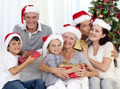 Family giving presents for Christmas — Stock Photo