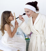 Mother applying blusher with her daughter — Stok fotoğraf