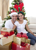 Happy couple celebrating Christmas at home — Stock Photo