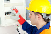 Caucasian electrician repairing a power plan — Stock Photo