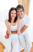 Enthusiastic couple finding out results of a pregnancy test — Foto Stock