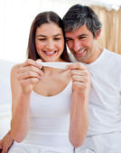 Glowing couple finding out results of a pregnancy test — Stock Photo