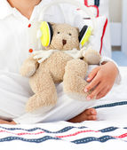 Close-up of a teddy bear with headphones on — Stock Photo