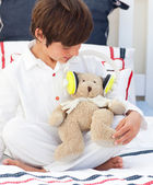 Close-up of a little boy playing with a teddy bear — Stock Photo