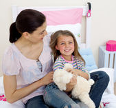 Happy mother and her daughter having fun — Stock Photo