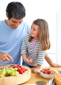 Happy father and his daughter having breakfast — Stock Photo