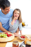 Jolly father and his daughter having breakfast — Stock Photo