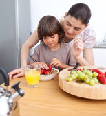 Smiling mother and her child having breakfast — Stock Photo